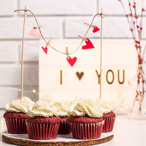 I love you written on a decorative lamp next to red cupcakes, red velvet with mascarpone cream. Valentine's day concept Sweet Food Sweet Dessert Cake Food And Drink Food Baked Day Valentine's Day  Cupcake Love Red White White Background Muffin Festive Holiday Happy Snack Gourmet Homemade Romance Lamp Decoration Berries