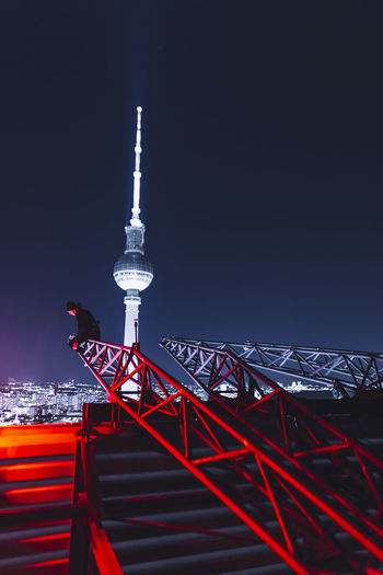 Berlin Germany EyeEm Architecture Built Structure Tower Night Sky Communication Tall - High Illuminated Building Exterior Red Travel Destinations One Person Check This Out Outdoors City Spire  Travel Exploring Cityscape City Low Angle View City Life
