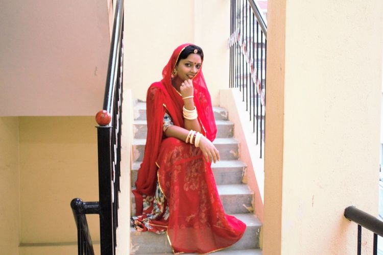 #bangles #Beuty #culture #dressed  #Incredible India #India #indianwomen #rajshathani #red #ritual #shypose  #stairs #thatsme
