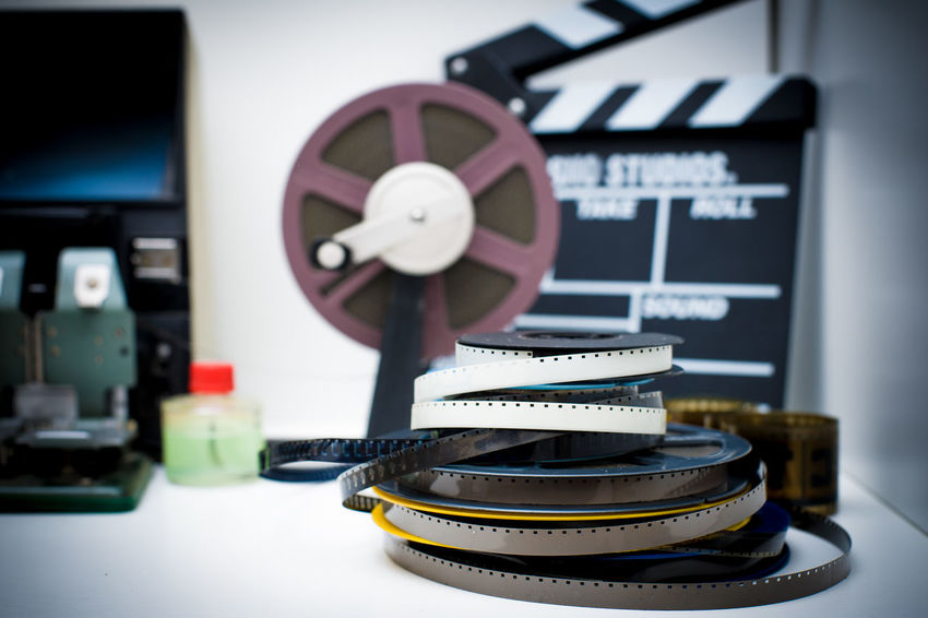 Editing desktop with super 8 film reels and movie symbols City Clapboard Clapper Clapperboard Desktop Editing Editing Machine Film Filmstrips MOVIE No People Reel Super 8 Symbol