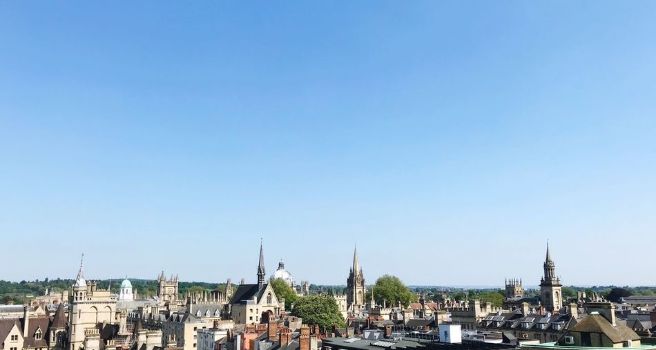 The Spires England Oxford City Oxford Spires Spires Oxford Sky Architecture Built Structure Copy Space Building Exterior Clear Sky City Nature Building Day Religion Travel Destinations Blue Travel Place Of Worship Tourism Outdoors Water Cityscape