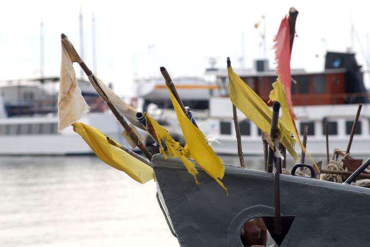 Close-up of yellow moored at harbor