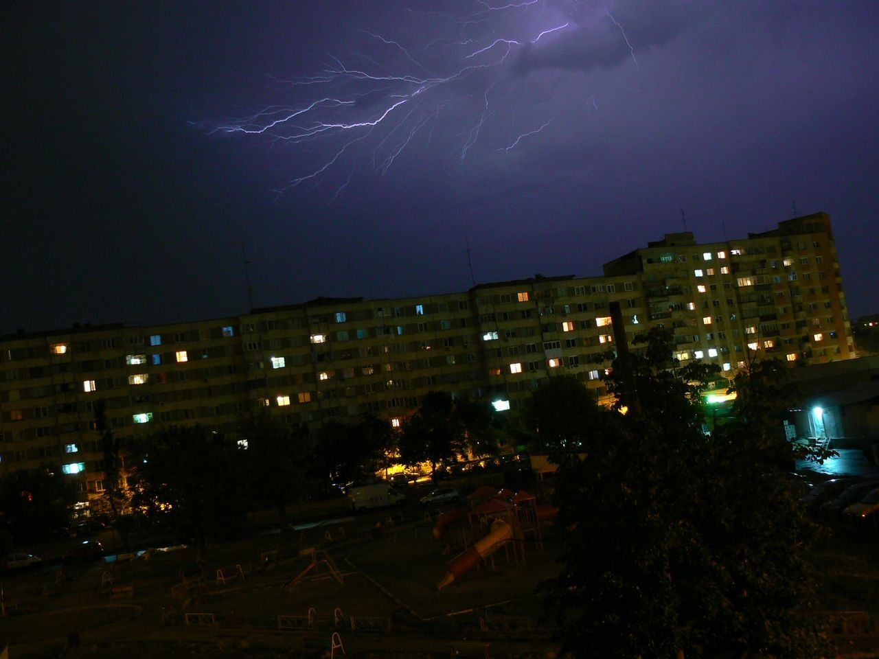 night, illuminated, lightning, thunderstorm, sky, weather, forked lightning, nature, power in nature, no people, danger, beauty in nature, outdoors, storm, building exterior, built structure, architecture, scenics, city, storm cloud, cityscape