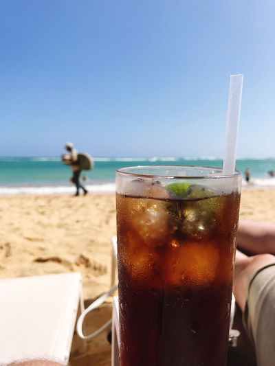 EyeEmNewHere Sea Beach Drink Sand Food And Drink Horizon Over Water Refreshment Clear Sky Day Outdoors Sky Nature Water Drinking Glass Close-up Animal Themes One Person Cuba libre drink relax Neighborhood Map