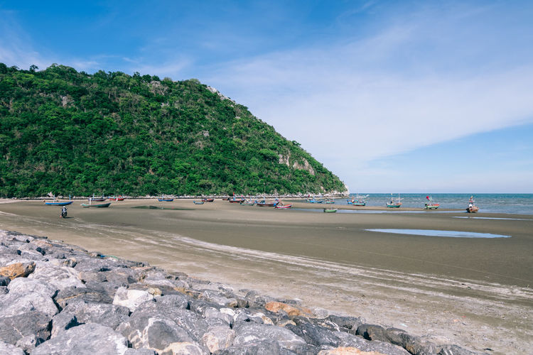 On the beach Water Sea Sky Beach Land Scenics - Nature Beauty In Nature Day Mountain Transportation Nature Rock Tranquil Scene Incidental People Tranquility Cloud - Sky Plant Solid Tree Horizon Over Water Outdoors Hua Hin