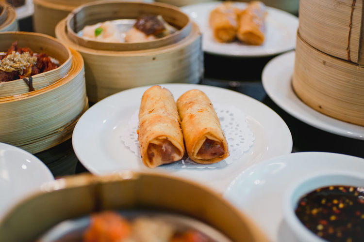 Close-up of dim sums served on table