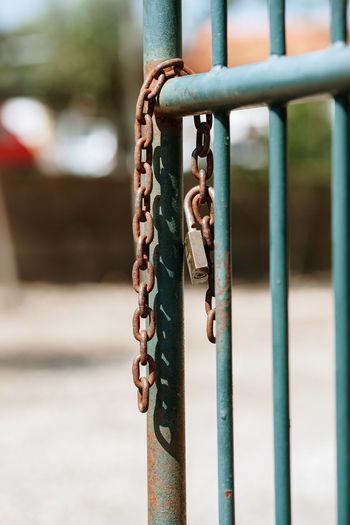 Chain Lock Unlocked Unlock Padlock Metal Focus On Foreground Close-up Day No People Safety Security Protection Rusty Outdoors Railing Barrier Fence Boundary Connection Gate Open Gate Padlocks Old Opened Thief Robbery Crime Crime Scene Lines Backgrounds Background Still Life