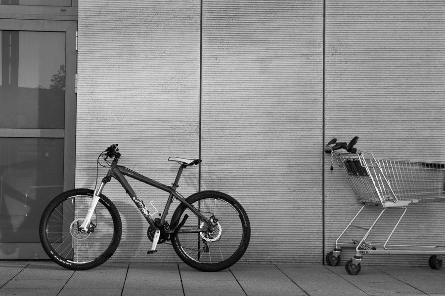Architecture Bicycle Bike Black & White Black And White Blackandwhite Concrete Concrete Jungle CyclingUnites Day Everyday Lives Everything In Its Place Fahrrad Horizontal Monochrome Photography No People Outdoors Shadow Shopping Cart Stationary Tire Transportation