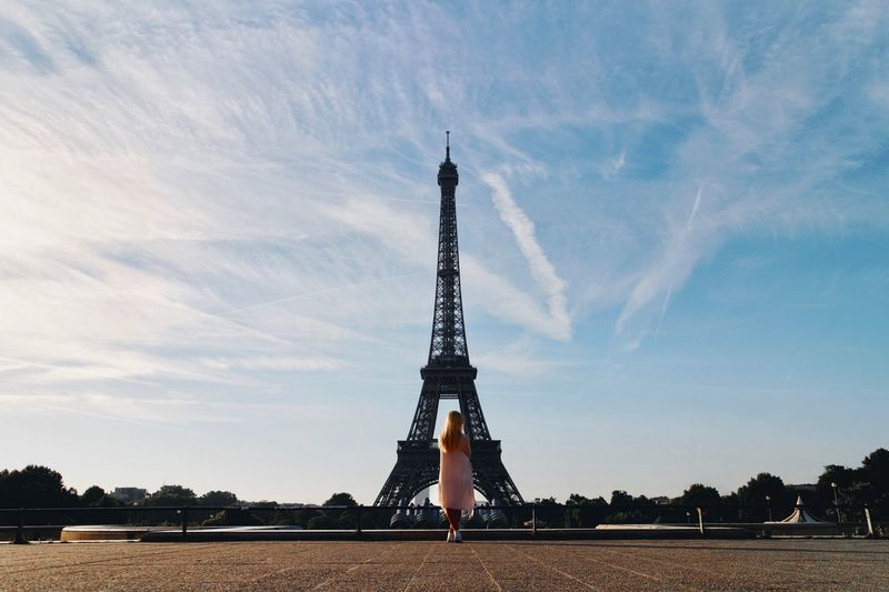Rear View Full Length Of Woman Standing Against Eiffel Tower