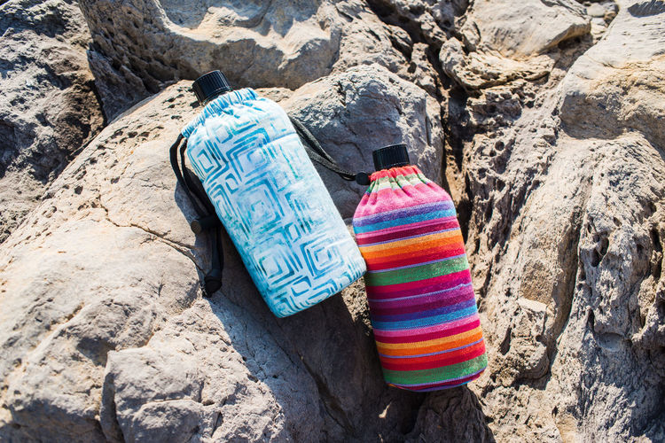 Hiking Travel Water Bottle Traveling Vacations Adventure Bottle Close-up Day Drinking Liguria Mountains Multi Colored Nature No People Outdoors Punta Chiappa Rock - Object Sunlight Tourism Travel Accessories Vacation