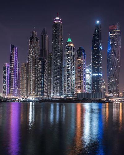 Illuminated buildings in city at night