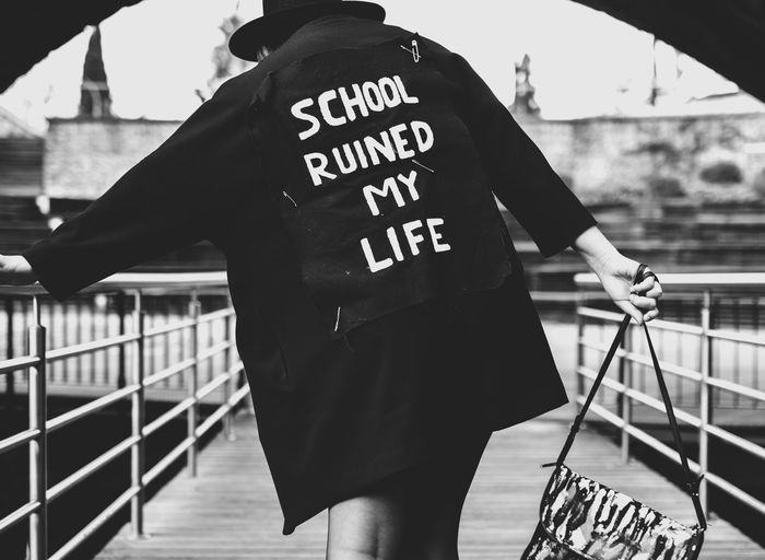 School Ruined My Life - series Communication Day Focus On Foreground One Person Outdoors People Railing Real People Rear View Text EyeEmNewHere