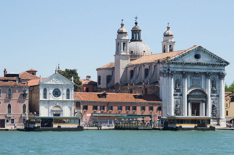 Architecture Bell Tower Built Structure Church Clear Sky Day Façade History In Front Of Italy No People Old Town Outdoors Place Of Worship Sea Tourism Town Venice Water Waterfront Waterfront Of V