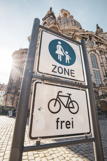 Dresden Text Communication Low Angle View Western Script Sign Architecture Built Structure Day City Information Building Exterior Road Nature Guidance Information Sign Sky No People Outdoors Road Sign Sunlight Message Dollar Sign Zone Fußgängerzone