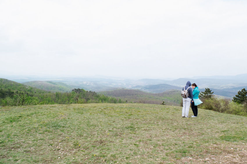 Adult Adults Only Adventure Backpack Bonding Copy Space Day Full Length Grass Hiking Landscape Mature Adult Mature Couple Men Mid Adult Mid Adult Men Mountain Mountain Range Nature Only Men Outdoors People Standing Togetherness Two People