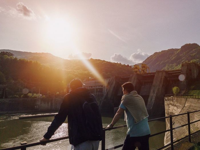 Hydroelectric dam... Backpack Concrete Environment Landscape Powerplant Water Outdoors Hiking Friendship Travel Friends Power Plant Hydro Hydroelectric Power Dam Sunlight Real People Nature Men Adult Lifestyles Togetherness Architecture Lens Flare Built Structure Building Exterior Sunset Railing Outdoors Leisure Activity