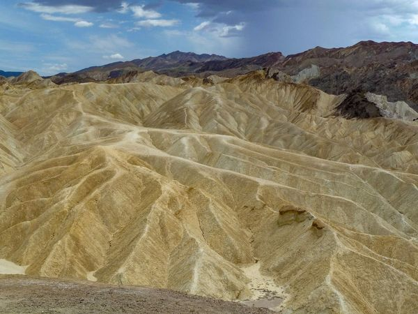 Zabriskie Point USA Clouds And Sky Clouds Wüste  Death Valley National Park Death Valley Zabriskie Point Mountain Sky Geology Landscape Physical Geography Tranquil Scene Nature Tranquility Scenics Beauty In Nature Outdoors Mountain Range Desert Day Cloud - Sky EyeEmNewHere