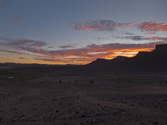 Sunset in the Sahara desert in Morocco Scenics - Nature Landscape Environment Mountain Sky Tranquil Scene Tranquility Beauty In Nature Outdoors Arid Climate Climate Morocco Sahara Desert Sunset Sunrise Mood Evening Valley Africa Mountain Range Table Mountain Barren Idyllic Orange Color