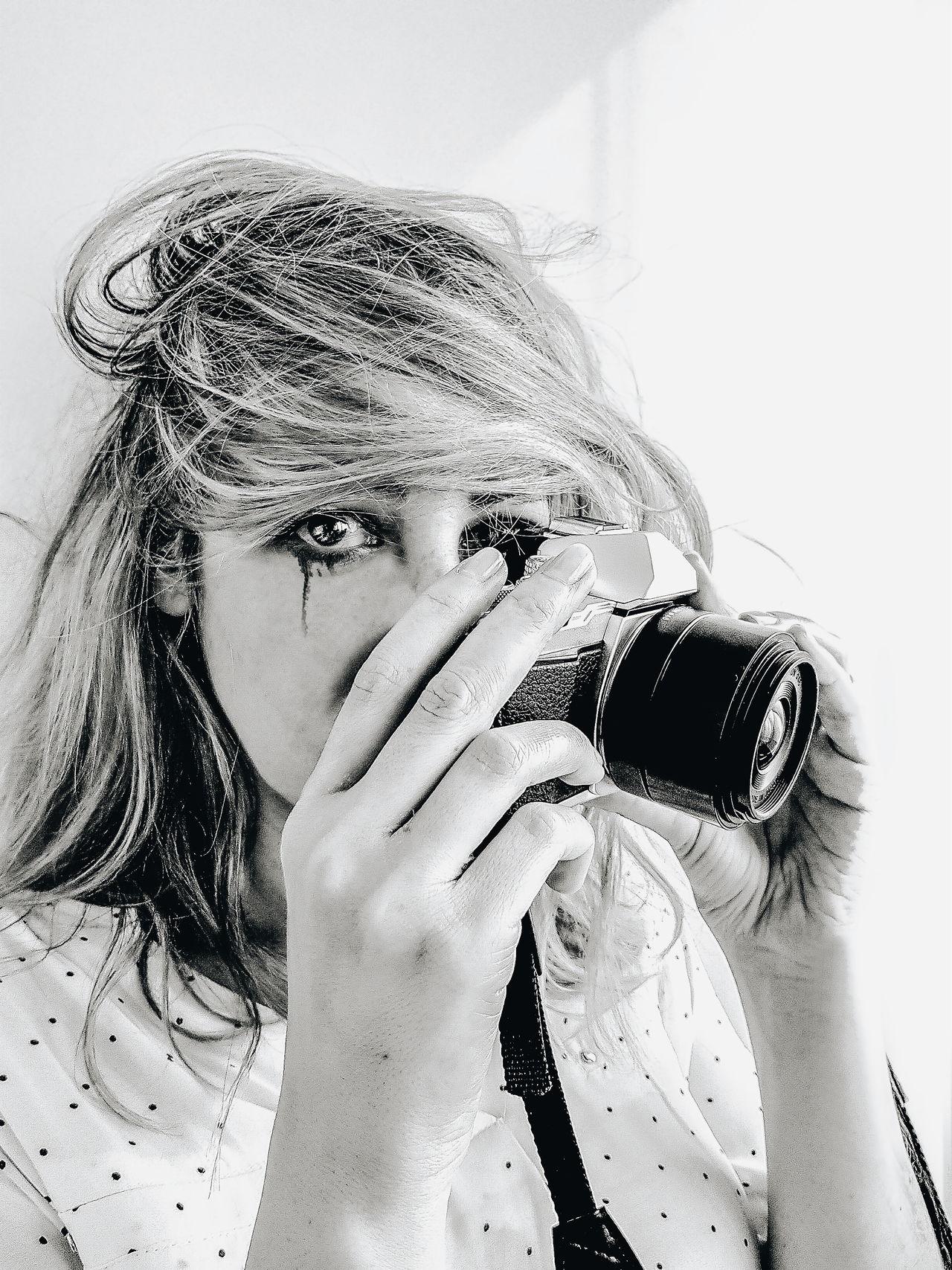 Close-up portrait of a photographer