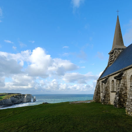 Sky Built Structure Architecture Water Building Exterior Building Religion Cloud - Sky Nature Land Day Sea Place Of Worship Grass Belief Spirituality No People Travel Destinations Outdoors Horizon Over Water Spire  étretat