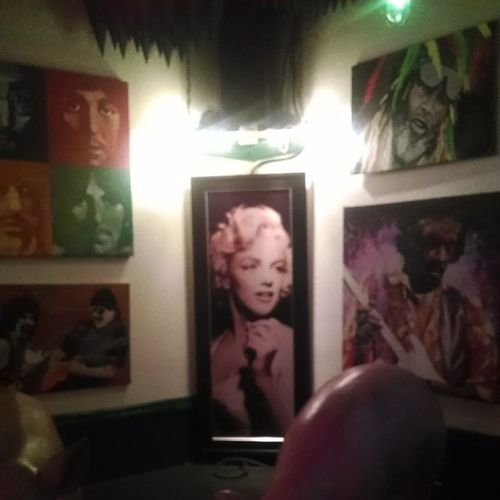 Hopefully the food in this joint is as good as the artwork they got hangin' up!