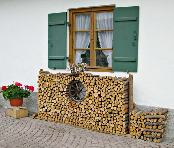 Bavarian Tradition Building Exterior Cut Woods Firewood Stack Flower House No People Outside Plant Potted Plant Residential Structure Window Wood Stacks