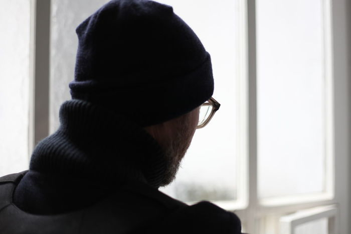Contemplation Depressed Depression Fashion Hat Home Interior Indoors  Light Male Man Moody Rear View Sad Serious Sunlight Window Window View Winter Winter Fashion Wintertime
