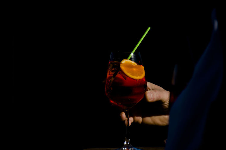 Human Hand Drink Alcohol Refreshment Human Body Part One Person Cocktail Drinking Glass Black Background Spritz Time  From My Point Of View EyeEmBestPics EyeEm Gallery EyeEm Best Shots Nikon D7100 Place Of Heart Live For The Story