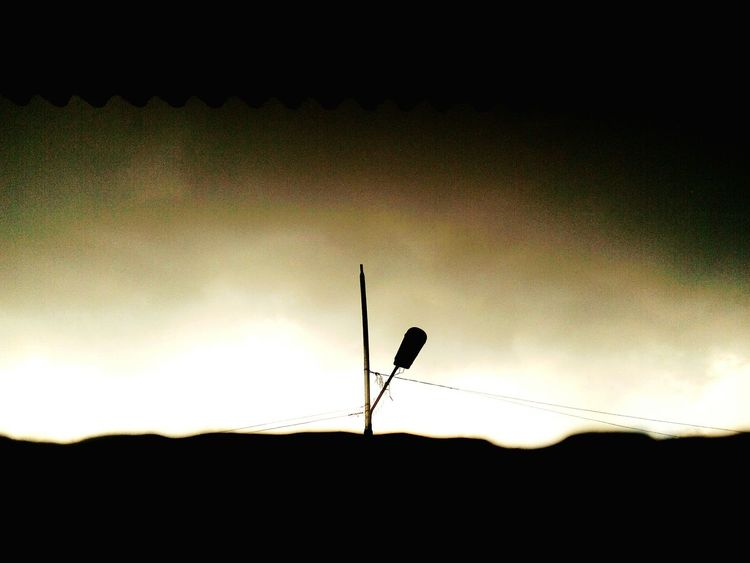 Sky Silhouette Outdoors Day No People Nature Mobilephotography Freshness Evening Streetlights And Shadow Streetlights And Sky Sunset Dayvsnight Silhouette Beforenight Orange Sky BeforeRain The Great Outdoors - 2017 EyeEm Awards