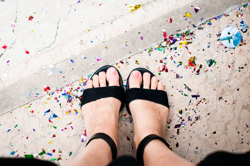Confetti Day Decent Event Fashion Feet Graduation Human Body Part Human Foot Human Leg Lady Legs Lifestyles Multi Colored Nail Polish Party People Personal Perspective Polite Sandal Serious Shoe Standing Step Women