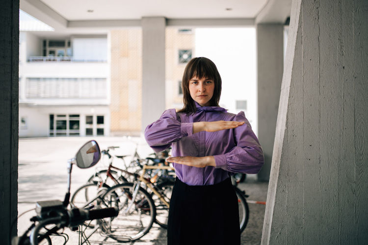 Portrait of a woman holding bicycle