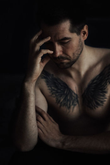Feelin kinda moody today... Self Portrait Tattoo One Person Indoors  Front View Portrait Shirtless Adult Studio Shot Black Background Young Adult Men Contemplation Hand Sadness Males  Young Men Handsome Waist Up Beautiful People Close-up Dark Chest Depression - Sadness