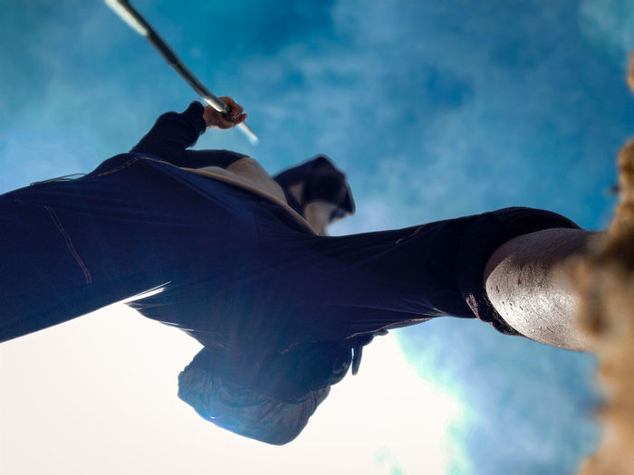 Directly below shot of man walking against sky