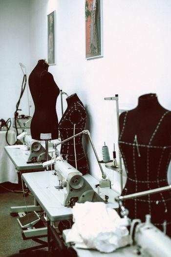 Black mannequins in a sewing workshop