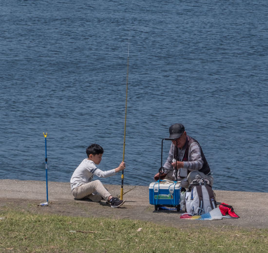 People fishing in water