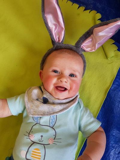 Portrait of smiling baby boy wearing costume rabbit ears