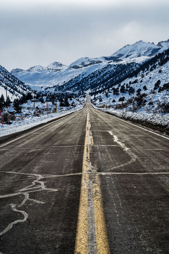 Road into winter mountain landscape