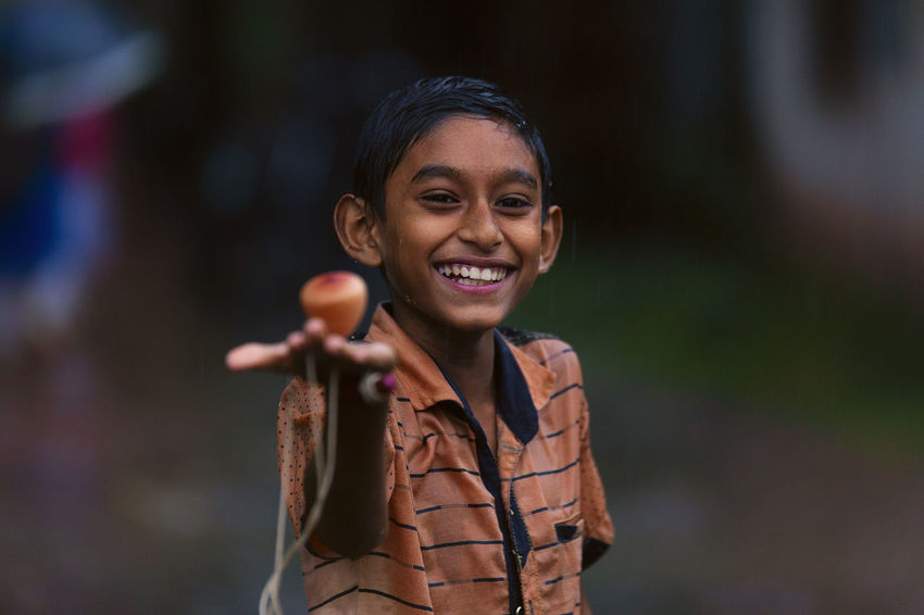 One Person Smiling Portrait Focus On Foreground Happiness Emotion Looking At Camera Toothy Smile Child Childhood Headshot Lifestyles Toys Playing Rain EyeEm Nature Lover EyeEm Gallery EyeEmNewHere Week On Eyeem
