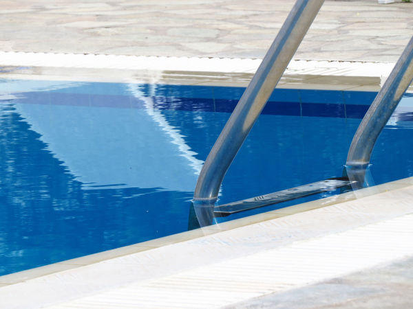 Azur Azure Blue Chlorine Cool Fresh Hotel Hotel Pool Ladder Part Of Pool Pool Ladder Pool Time Poolside Refreshing Rippled Rippled Water Swimming Swimming Pool Tranquil Scene Tranquility Vacation Water