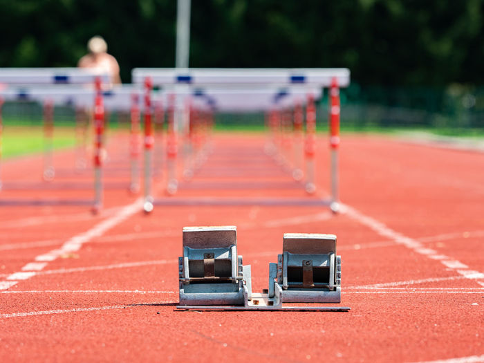 Obstacle course training. athletics starting blocks and red running tracks in a stadion