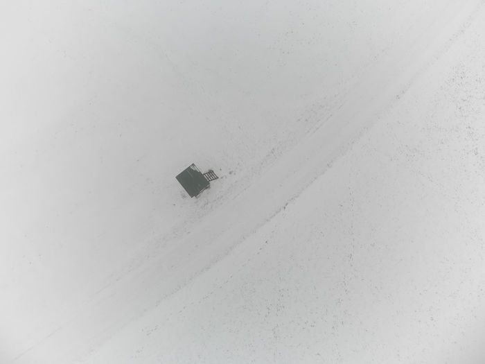 Low angle view of snow on building window