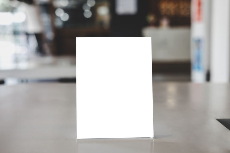 Close-up of empty paper on table at restaurant