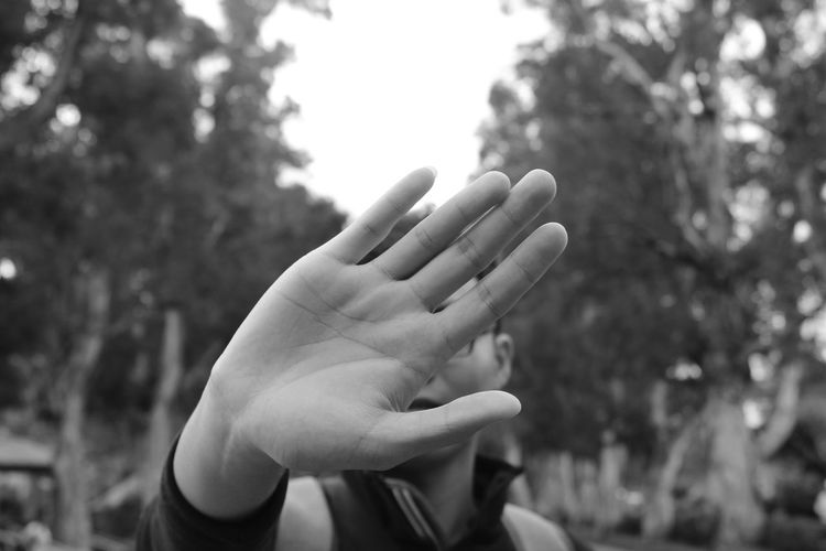 Close-up of man showing stop gesture