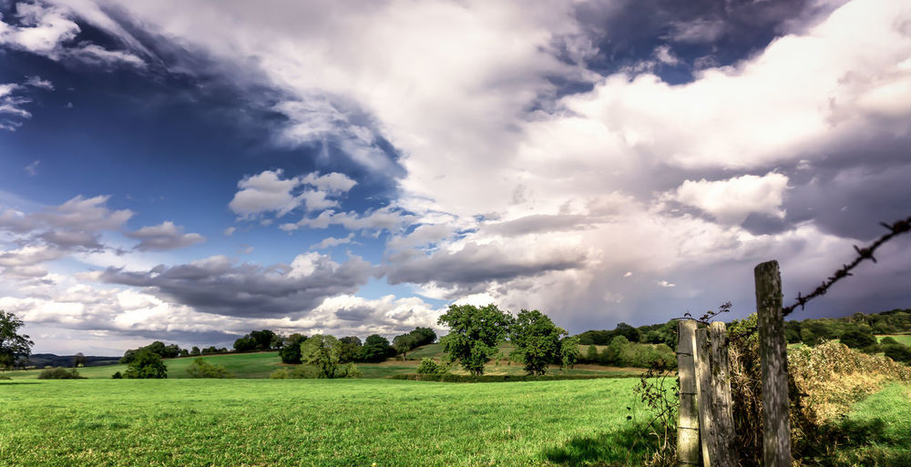 --Grass and sky-- Atmosphere Atmospheric Mood Cloud Cloud - Sky Cloudscape Cloudy Dramatic Sky Moody Sky Outdoors Sky Storm Cloud Tranquil Scene Tranquility