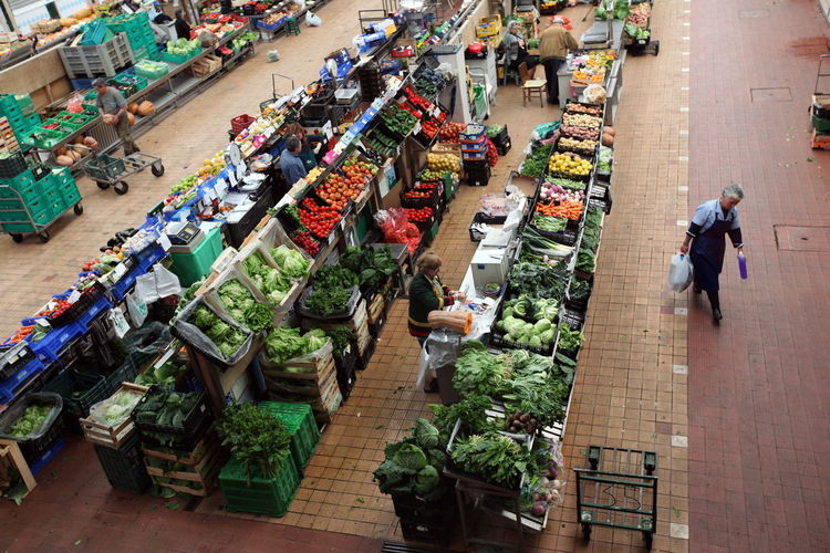 High angle view of people shopping in vegetables and fruits market