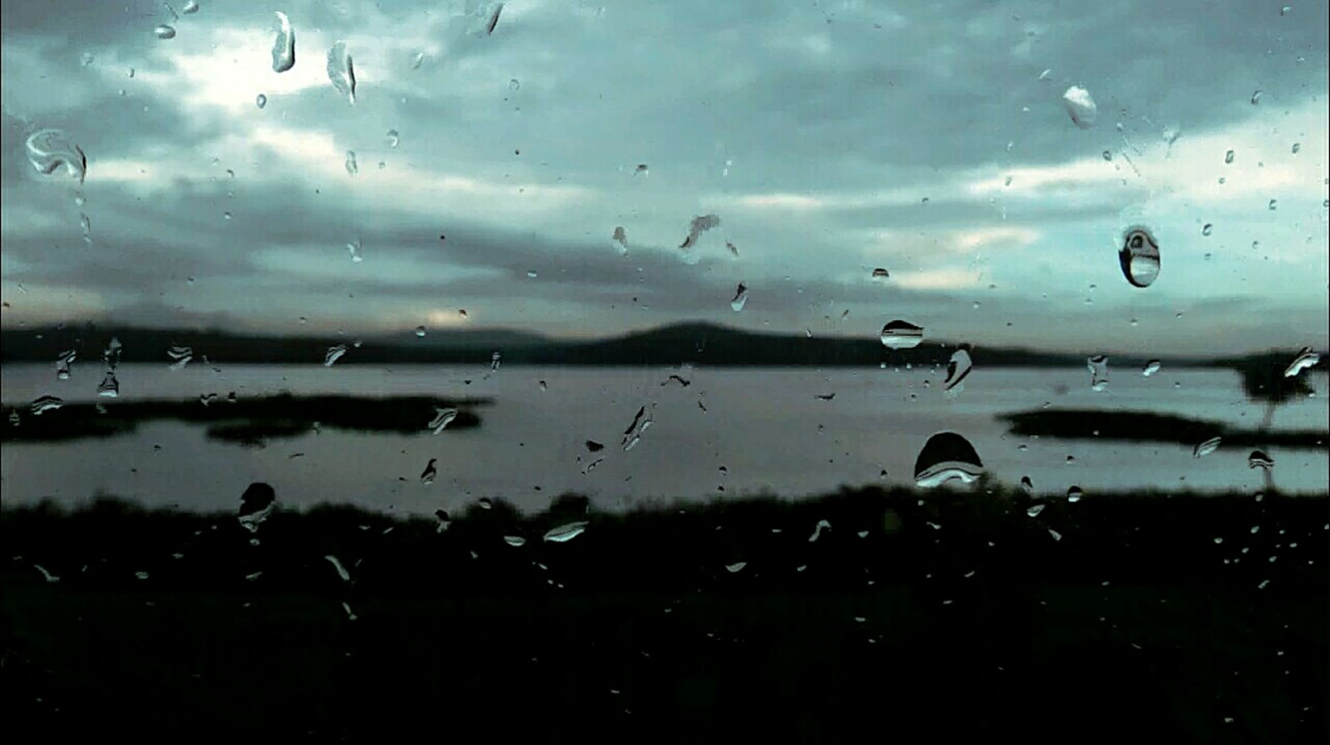 water, sky, drop, transparent, cloud - sky, wet, rain, window, weather, glass - material, cloud, indoors, flying, nature, cloudy, dusk, raindrop, silhouette, glass, focus on foreground