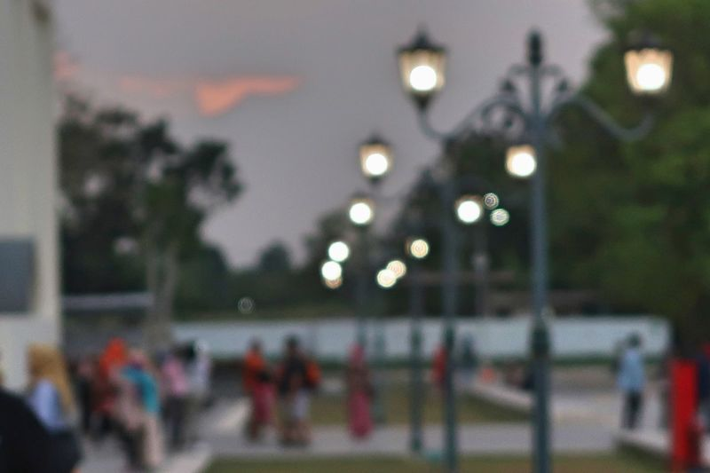 Blur Blur Background Blur Light Blur Lighting Blur Lights Blurred Background Blurry City Crowd Defocused Focus On Foreground Group Of People Illuminated Incidental People Large Group Of People Leisure Activity Light Lighting Equipment Men Nature Night Outdoors Real People Street Street Light