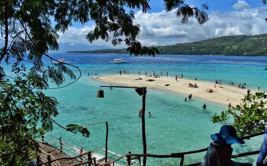 One of the many small beaches in the beautiful Philippine islands Landscapes Landscape White Sand Beach Clear Water Cebu Sumilon Island Itsmorefuninthephilippines Vacations My View Beach View Water Tree Plant Sky Sea Nature Cloud - Sky Beauty In Nature Beach Land Outdoors