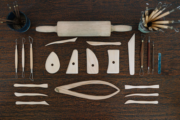 Neatly Organized Tools for Ceramic Work Artisan Ceramic Art Craft Craft Tool Craftmanship Directly Above High Angle View Organized Preparation  Process Shaping Tools Table Tools Wood - Material Work Tool Workshop