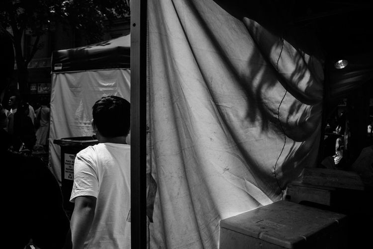 Rear View Of Man At Market Stall In Chinatown